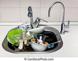 A lot of dirty dishes in the sink