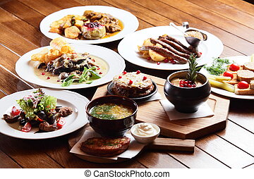dishes with different food - a lot of dishes with different...