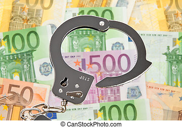euro bank notes with handcuffs - a lot of euro bank notes ...