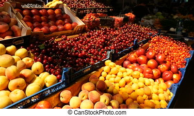 A lot of fruits and berries at the counter at the market
