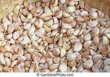A lot of garlic in basket