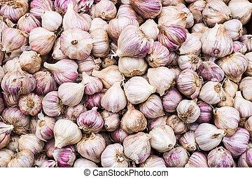 A lot of garlic on the casserole pattern backgroun