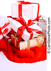 A lot of gifts with ribbons on the red cloth, on a white background.