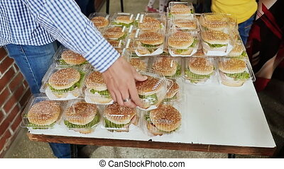 A lot of hamburgers in the form of a pyramid people...