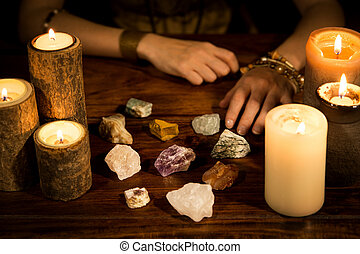 healing stones, candles and fortune teller hands, concept ...