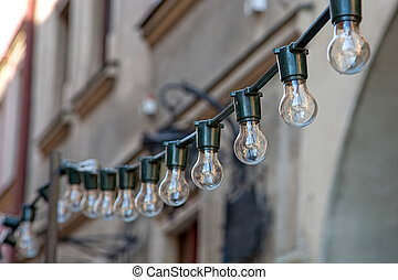 A lot of light bulbs on the cable