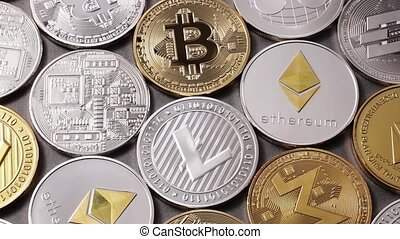 A lot of metal coins of crypto currency LTC, ETH, BTC, XMR,...