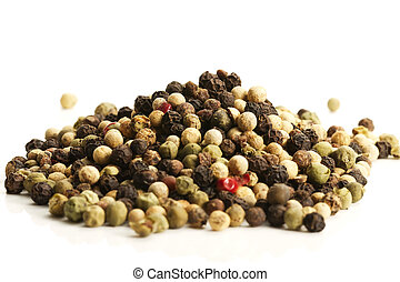 a lot of mixed peppercorns on white background