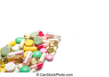 A lot of multi-colored pills on a white background. Dietary supplements. Place for text. Coronavirus