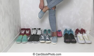 A lot of multi-colored women's sneakers. Selection - A...