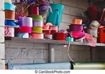 multicolored rolls with ribbons on the shelves
