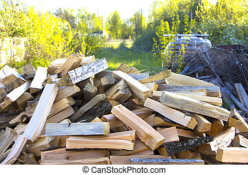 A lot of oak wood lying on the ground