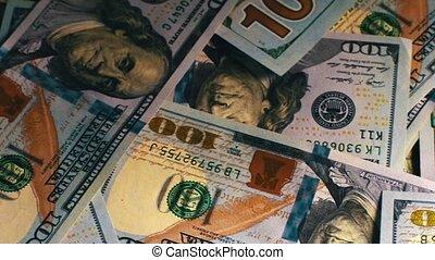 A lot of one hundred dollar bills. Slider shot. - A lot of...