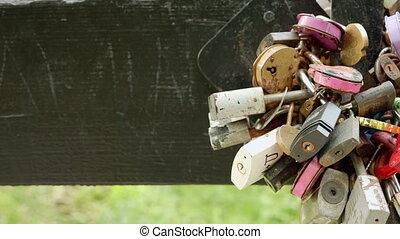 A lot of padlocks on the bridge. Autumn daytime. Smooth dolly shot