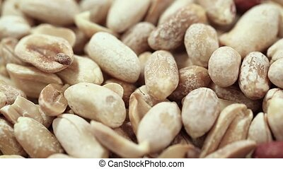 a lot of peanuts peeled close-up
