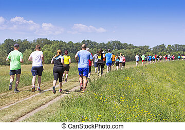 A lot of people on Marathon running in nature
