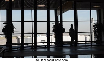 A lot of people passengers -travellers silhouette in the airport