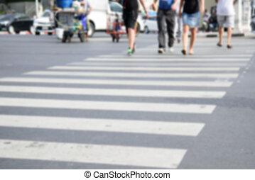 a lot of people walking at Crosswalk