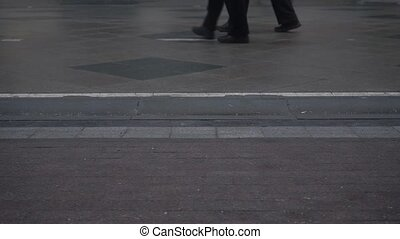 A lot of people walking in winter pedestrian street, slow motion shot at 60 fps