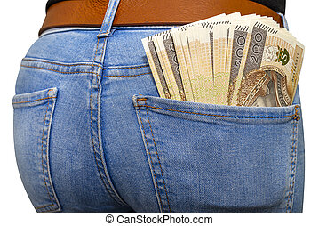 A lot of Polish banknotes with a nominal value of 200 PLN inserted into the back pocket of women blue denim pants, isolated on a white background with a clipping path.