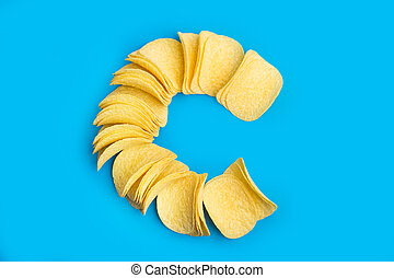 A lot of potatoes chips in line
