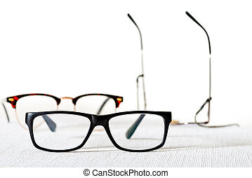 reading glasses - a lot of reading glasses on the white ...