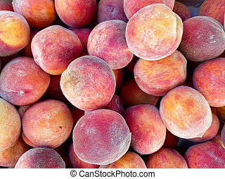 a lot of ripe peaches as a background