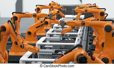 A Lot of Robotic Arms Assembling Computers On Conveyor Belt. Modern Advanced Automated Process. Looped 3d Animation. Business and Technology Concept. 4k Ultra HD 3840x2160.