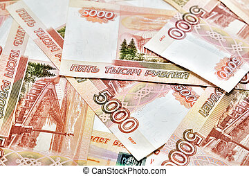 A lot of Russian money. Denominations of five thousand rubles