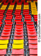 A lot of seats in stadium