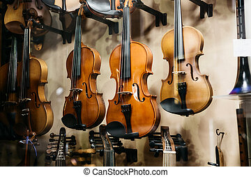 A lot of violins in a shop window