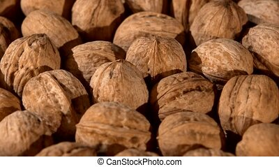 A lot of walnuts, rotation, background, close up