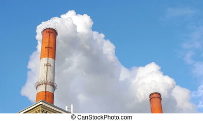 A lot of white smoke from the chimney at the plant. 4K