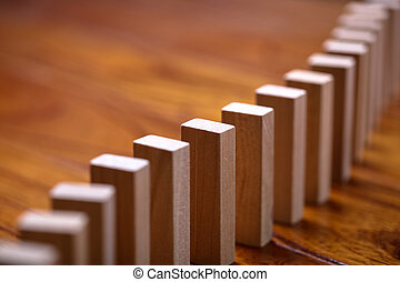 Domino Effect - A lot of wooden block standing in a line. ...