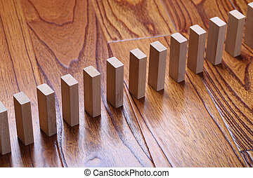 Domino Effect - A lot of wooden block standing in a line....