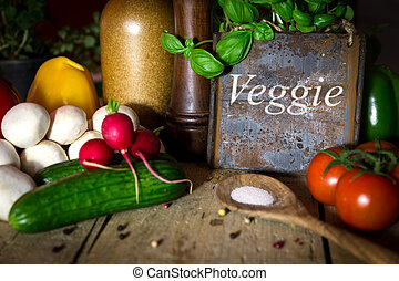 a lots of healthy vegetables on a wooden table, sign with word v
