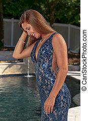 A Lovely Brunette Elegant Model Enjoys The Poolside Before Prom