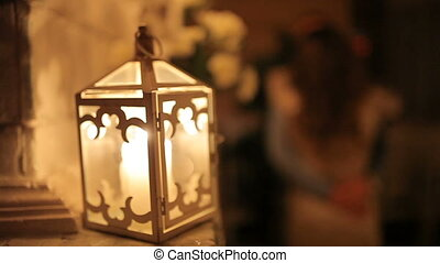 A loving couple dines by candlelight near the fireplace