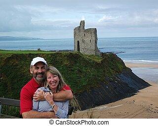 A loving couple near a castle on