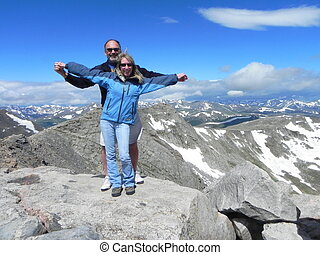 A loving couple on a mountaintop