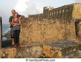 A loving couple on part of a fort