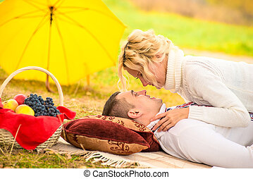 a loving couple relationships. shooting in the autumn park