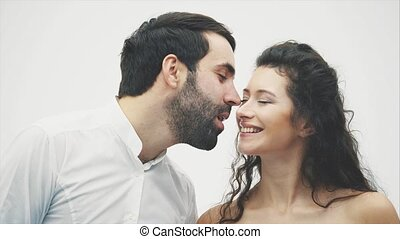 A loving husband and woman are getting closer to kiss each...