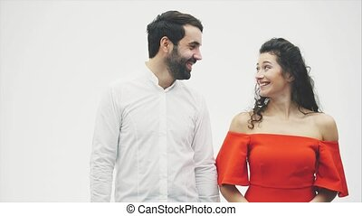 A loving husband and woman are getting closer to kiss each other. Happy young sensual couple. Touching his nose smiling with his eyes closed. Enjoying intimate sensuality in the concept of love. Face close-up side portrait.