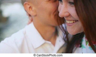 Man whispering in the ear of his girlfriend prank.
