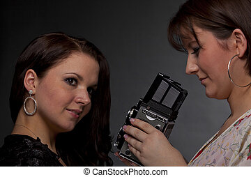female photographer taking pictures