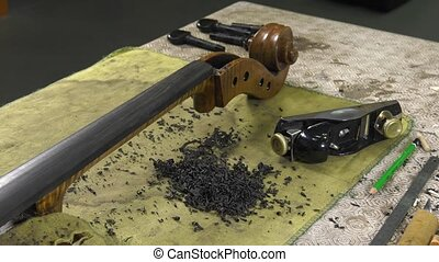 a luthier repairs a cello - luthier leveled the ebony...