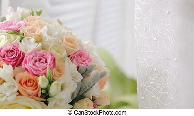 A luxurious wedding bouquet on the white windowsill