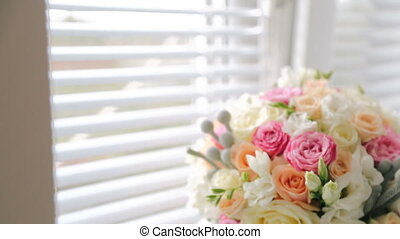 A luxurious wedding bouquet on the windowsill