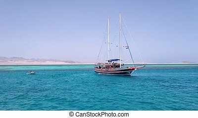 A luxurious wooden sailboat in the Red Sea against the blue sky of the unique Ras Mohammed nature reserve, diving, summer, vacation.